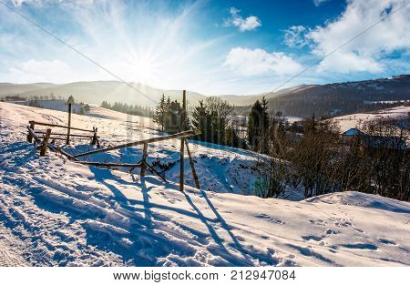 Broken Fence On A Snowy Slope In Rural Are