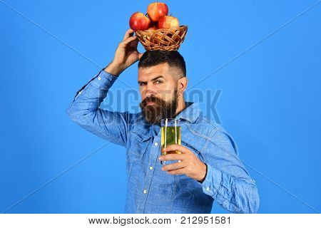 Guy Presents Harvest. Man With Beard Holds Wicker Fruit Bowl