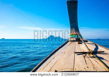 Closeup of traditional longtail boat in sea at Aonang beach against blue sky