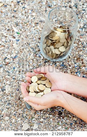 The Vertical View Of Investment, Retirement, Taxes And Passive Income Concept. Coins In A Glass Jar