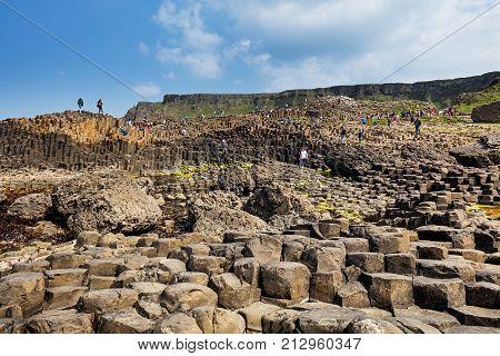 Giant's Causeway, Northern Ireland - JUN 5: thousands of tourists visiting this World Heritage Site on Jun 5, 2016 in Antrim, Northern Ireland. 40 000 basalt columns from ancient volcanic eruption