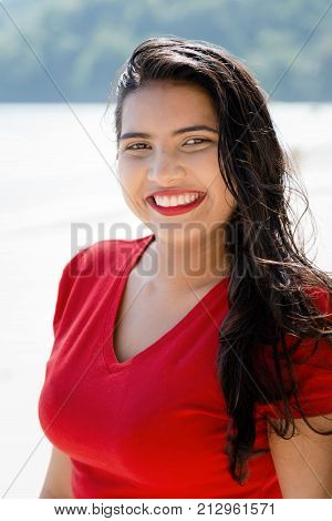 Happy Young Woman Girl With A Big Smile By The Beach Enjoying The Sunshine.