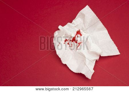 A photo of used bloody toilet paper. Blood drops and traces. Hemorrhoids, constipation treatment health problems. Menstrual or hemorrhoids bleeding