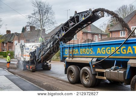 LONDON UK - CIRCA 2013: Roadworks to resurface the tarmac of a residential road in London UK