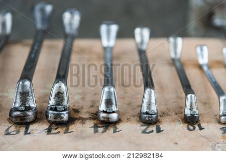 wrenches on garage wall set of wrenches handy industrial toolold wrenches in mechanic workshophandy tool for motor vehicle mechanic use to fix motorcycle and car