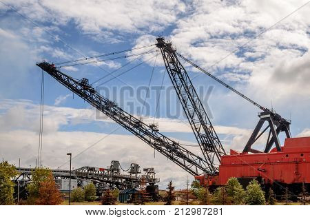 Heavy equipment for oil sands industry red crane.