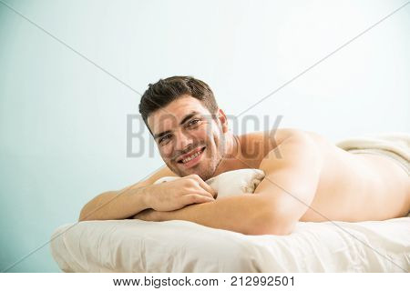 Man Lying On A Massage Bed