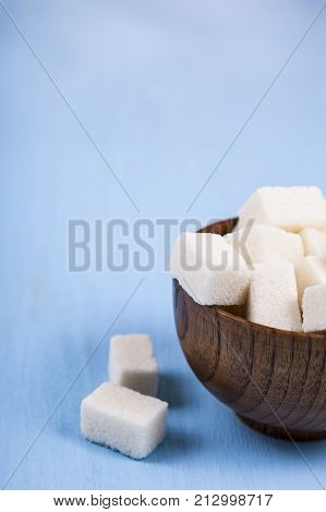 Sugar In A Wooden Bowl And A Spoon