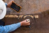 Ultrasonic test to detect imperfection or defect of steel plate in factory NDT Inspection. poster