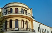 Modernist townhouse with balcony in Kos Town Greece poster