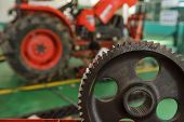 tractor part of the combine at the plant awaits assembly tractors and agricultural machinery maintenance and exports. poster