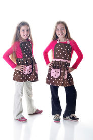 twin sisters in polka dot aprons
