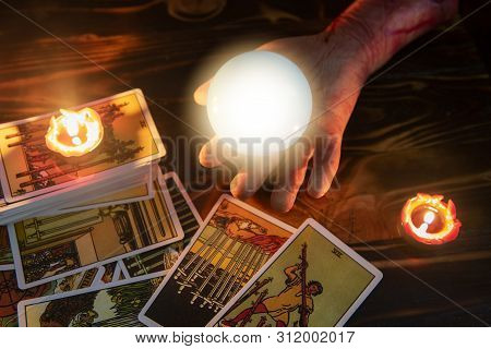Tarot Cards And Crystal Ball Reading Psychic By Zombie Hand With Candlelight Well As Divination