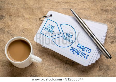 Pareto 80-20 principle concept - handwriting and sketch on index cards with a cup of coffee