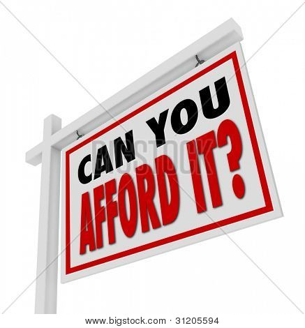 A white house for sale sign with the words Can You Afford It? asking the question of whether your money budget can handle a home buy or mortgage
