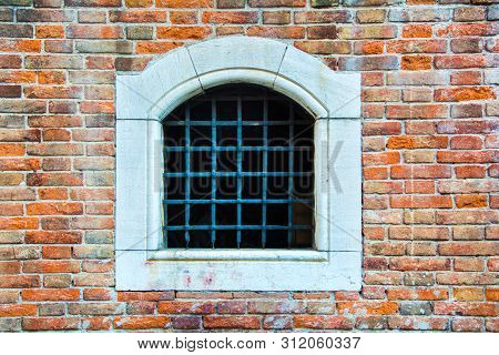 Venice, Italy - Sep 30, 2018: An Ancient Window Closed By A Lattice In The Building Of The Fish Mark