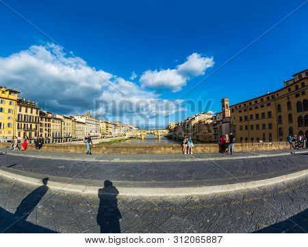 Florence, Italy - May 10, 2019: View Of The Old Bridge Ponte Vecchio From The St Trinity Bridge