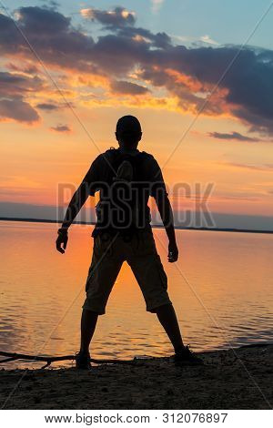 Silhouette Of Tourist And A Beautiful Landscape