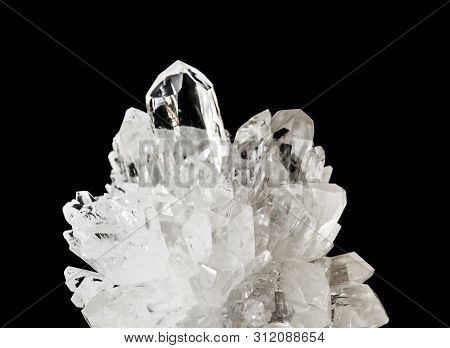 Beautiful Druse Of Transparent Crystals Of Rock Crystal, Isolated On A Black Background, Closeup. Ro