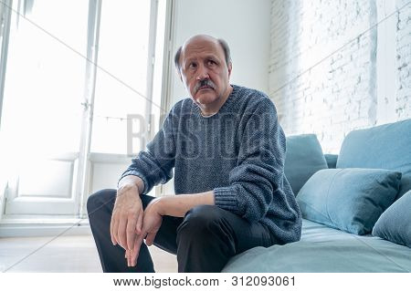 Sad Unhappy Old Senior Man Suffering From Memory Loss And Alzheimer Feeling Depressed And Lonely