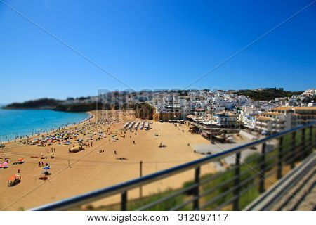 View On The Beach Praia Do Tunel And Albufeira In Algarve, Portugal. Tilt Shift Effect.