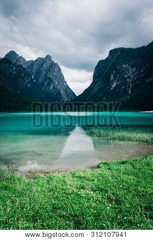 Dobbiaco Lake In The Dolomites Alps, Summer Landscape, Bolzano, Italy.