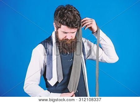 Hard Choice To Make. Bearded Man Choosing Tie From Luxury Collection, Choice Concept. Salesman Offer