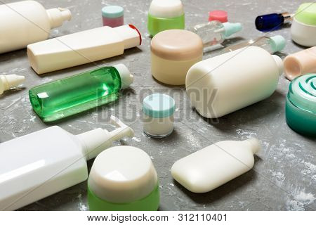 Group of plastic bodycare bottle Flat lay composition with cosmetic products on green background empty space for you design. Set of White Cosmetic containers, top view with copy space poster
