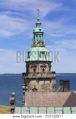Helsingor, Denmark - June 23, 2019: Medieval Kronborg Castle On The Oresund Strait, Tower On A Backg