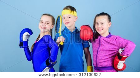 Sporty Siblings. Girls Kids With Boxing Sport Equipment And Boy Tennis Player. Ways To Help Kids Fin