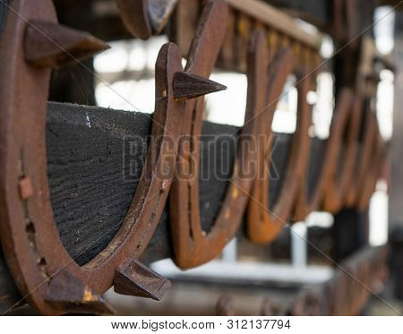 Rusty Vintage Horseshoes In A Row Hanging On Wooden Post