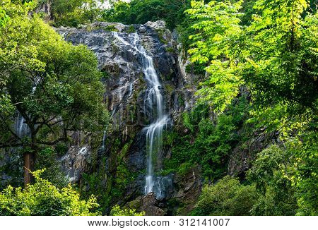 Waterfall In Tropical Forest At Khlong Lan National Park, Kamphaeng Phet, Thailand.