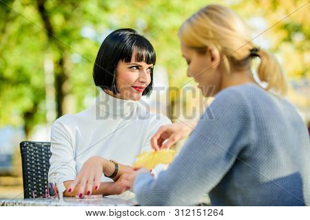 Friendship meeting. Trustful communication. Friendship or rivalry. Girls friends drink coffee talk. Conversation of two women cafe terrace. Friendship friendly close relations. Revelation and support poster