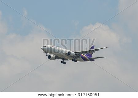 Passenger Airplane Landing At The Airport