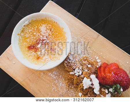 Creme Brulee - Traditional French Vanilla Cream Dessert With Caramelised Sugar On Top, Strawberry, A