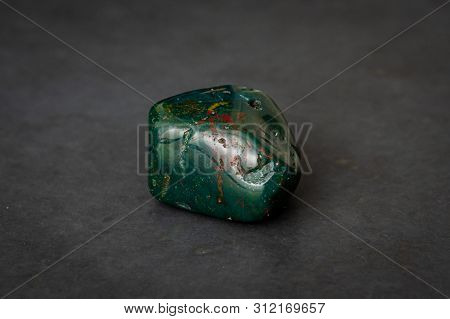 Indian Achat Deep Green Gemstone With Red And Yellow Structures All Over It