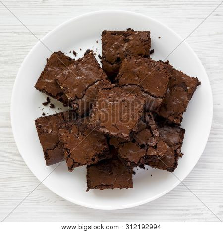 Top View, Homemade Chocolate Brownies On A White Plate On A White Wooden Table. Flat Lay, Overhead,