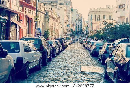 Buenos Aires, Argentina - May 6, 2019: Old Narrow Street Is Crowded With Parked Cars In Buenos Aires