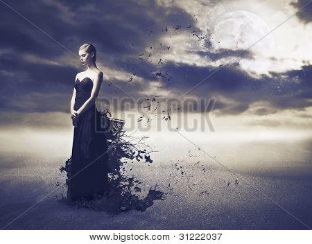 Beautiful woman wearing an evening gown melting away