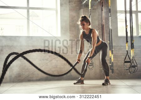 Preparing For The Competition. Young Athletic Woman With Perfect Body Doing Crossfit Exercises With
