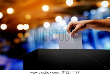 Hand Holding Ballot Paper For Election Vote Concept.vote Is Very Important For Our Nation.everyone D