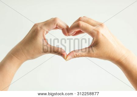 poster of woman show hand signs posturing to heart shape; by splice fingertips together (left thumb with right thumb and left forefinger with right forefinger) on white background; concept of telling love.