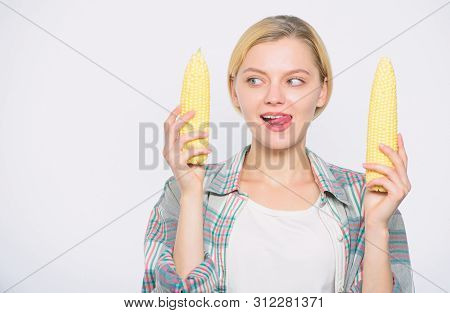 Raw Or Cooked. Agriculture And Cultivation. Corn Crop. Vitamin And Dieting Food. Happy Woman Eating