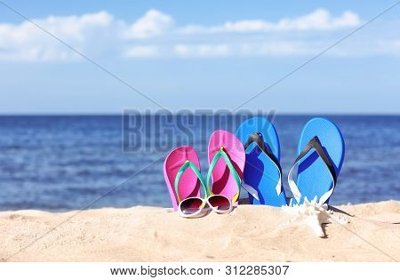 Composition With Beach Accessories On Sand Near Sea In Summer. Space For Text