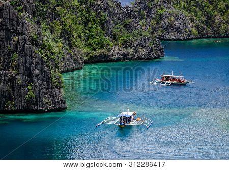 Tourist Boats On The Kayangan Lagoon In Coron, Philippines. Kayangan Lake, Located In Coron Island,