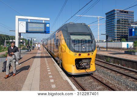 Amsterdam, The Netherlands - June 06, 2018: Express Train Waiting At Railway Station Amsterdam Zuid