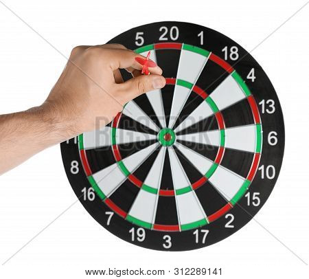 Young Man Throwing Dart At Board On White Background, Closeup