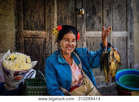Vendor At The Local Market In Inle Lake, Myanmar