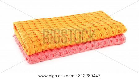 Folded Colorful Kitchen Towels On White Background