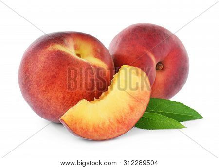 Sweet Juicy Peaches With Leaves On White Background
